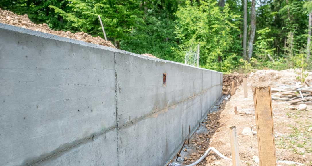Comment faire la Fondation d'un mur en parpaing?